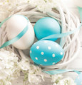 Easter Decoration with Eggs and Flowers on White Wooden Backgrou